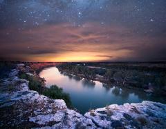 dark sky gold stars sunset dinner
