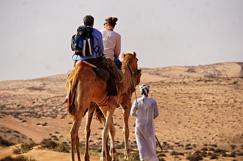Camel safari trekking tour in the desert Wahiba Sands