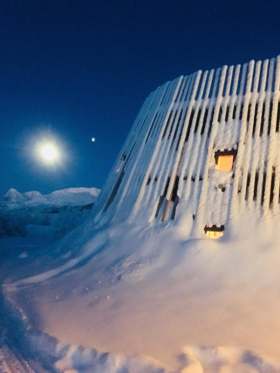 Superior overnight tour with snowmobile to the surroundings of swedens highest mountains