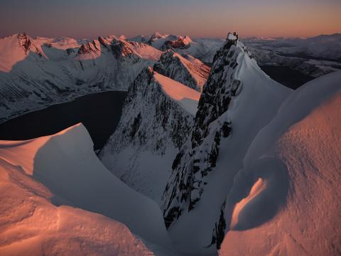 https://img.rezdy.com/PRODUCT_IMAGE/176932/Senja_fjord_snowymountain_med.jpg
