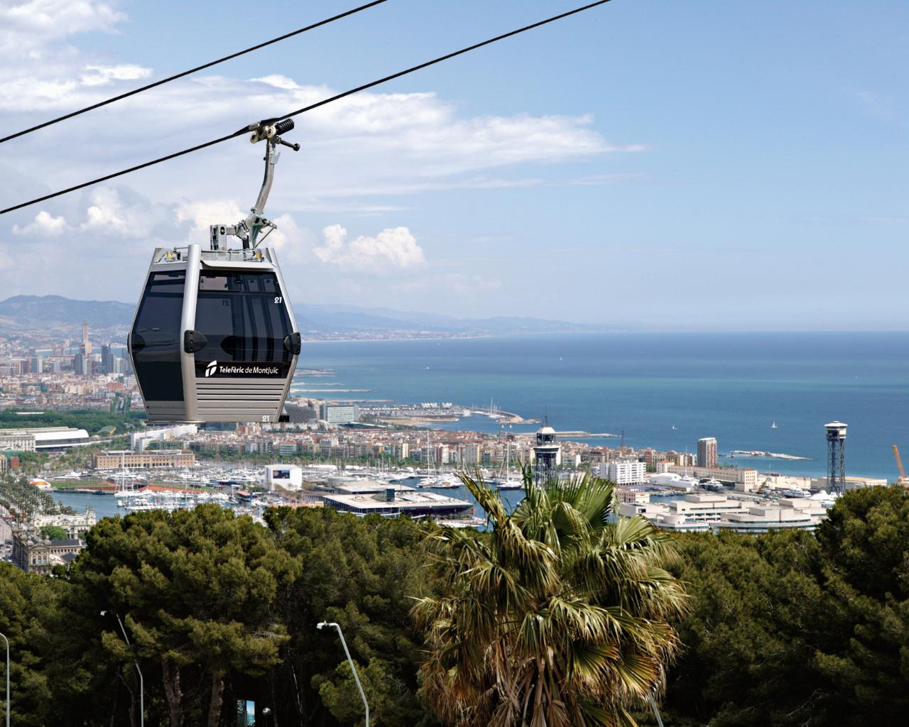 360° Barcelona on e-bike, catamaran and cable car tour - Half Day