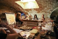 The Wine and Cheese Experience in a medieval cellar