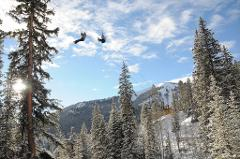 5-HOUR THRILL SEEKERS COMBO - PERFORMANCE SNOWMOBILING PLUS ZIP LINING WITH LUNCH.  Guide Gratuities are not included.