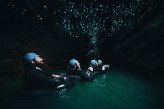 WAITOMO TOURS: Raglan to The Legendary Black Water Rafting Co. Black Abyss