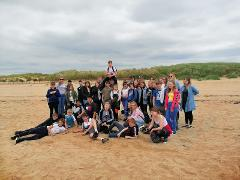 Liverpool Guided day out for schools  - 138m Tower Tour, Iron Men on the Beach & choice of meal and drink
