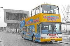"""Live Guide"" Open Top Bus Hop on & off City Explorer & guided 90-minute Beatles themed walking tour combined ticket includes ""Double Fantasy"" John & Yoko exhibition & visit the Cavern Club"