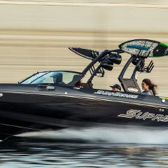 SURF BOAT WITH SAM'S DOCK DRIVER