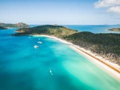 Ultimate Whitehaven Beach & Guided e-Mountain Bike Whitsunday Island Experience